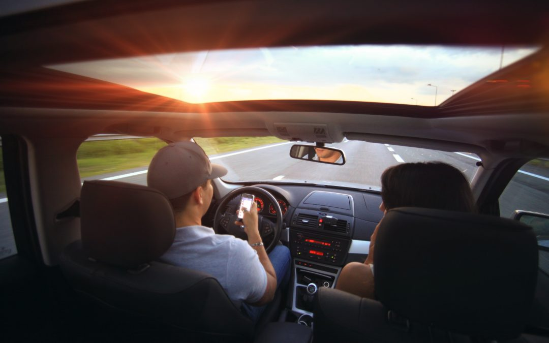 Distracted Driving Laws and Your Insurance: Keeping Your Cost